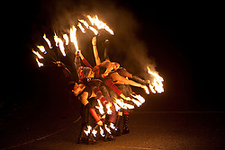 United States, Washington, Seattle,female fire dancers at Winter Solstice Festival
