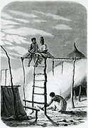 'Natives of Senegal, West Africa,  lighting a  fire to keep away mosquitoes. Malaria, caused by a protazoa transmitted by mosquitoes, is still a problem in Senegal. Engraving, London, 1874.'