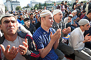 Tajik migrants pray for Eid al-Fitr in Moscow on August 8, 2013