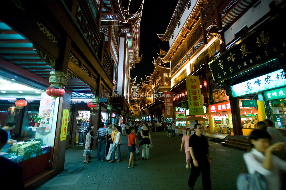 Night time street scene in the Yuyuan shopping district of, Shanghai, China.  Shanghai is one of China's most important cultural, commercial, financial, industrial and communications centers.  It is also one of the busiest ports in the world and is a major economic center.