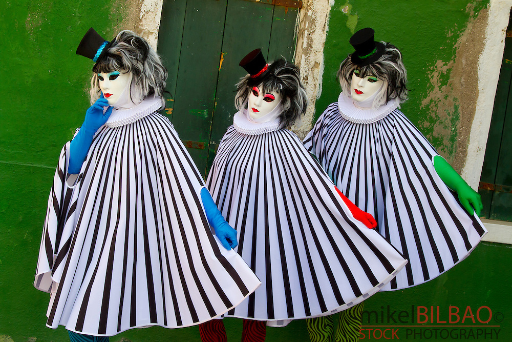 People in mask disguise in carnival. Burano island. Venice, Italy.