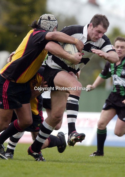 Hawkes Bay captain Michael Johnson break through the defence during the NPC second Division clash between Hawkes Bay and Thames Valley played at McLean Park, Napier, New Zealand, today, 21 August 2004. Hawkes Bay won the match 88-0<br />