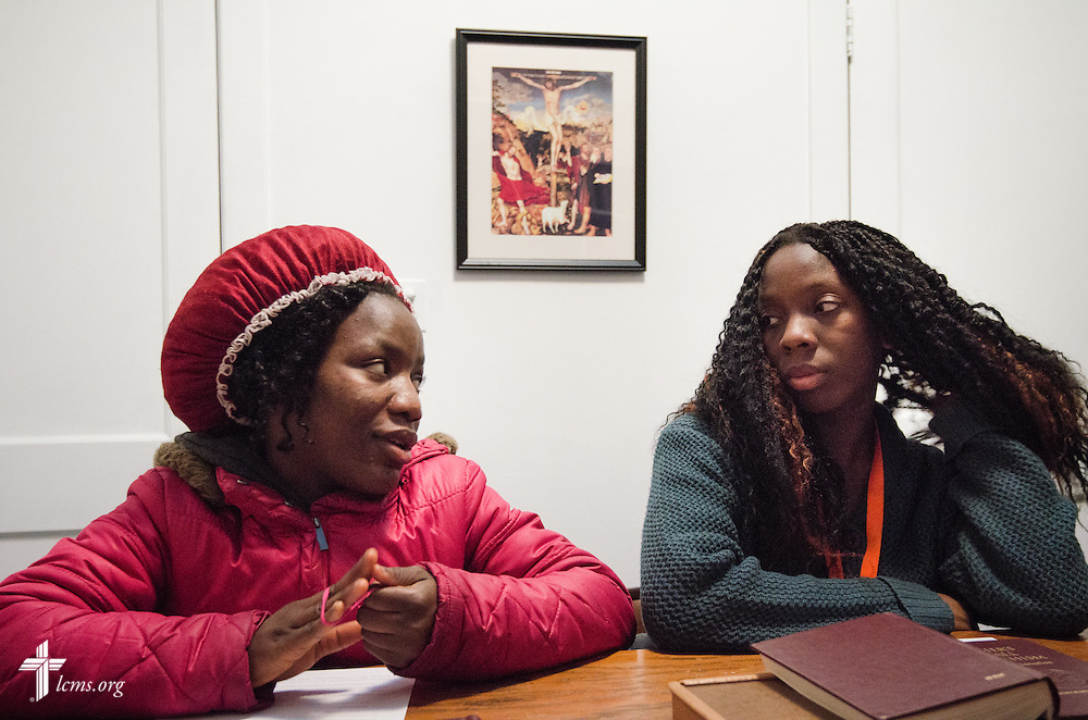 Princess Greah, 17, (left) questions the Rev. Roy Axel Coats (not pictured) during a youth confirmation study session Thursday, March 27, 2014, at Lutheran Church of the Redeemer in Baltimore, Md. Seated next to her is Samantha Nah, 16.  LCMS Communications/Erik M. Lunsford