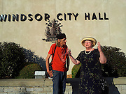 Windsor, Canada, 2012. Rockin' Robbee, a musician, speaks with Victoria Cross, his lawyer, outside Windsor City Hall. Rockin' is hoping to overturn his banishment from city hall  after his personal protest against a city councillor.