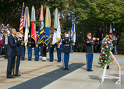 "United States President Barack Obama, left, and US Army Major General Bradley A. Becker, Commander, US Army Military District of Washington, left center, stand at attention as a bugler blows ""Taps"" during a wreath-laying ceremony at the Tomb of the Unknown Soldier at Arlington National Cemetery in Arlington, Virginia on Veteran's Day, Friday, November 11, 2016.<br /> Credit: Ron Sachs / Pool via CNP"