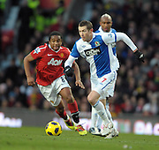 Brett Emerton (Blackburn) takes on Anderson (Manchester United) during the Barclays Premier League match between Manchester United and Blackburn Rovers at Old Trafford on November 27, 2010 in Manchester, England.
