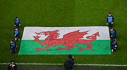 CARDIFF, WALES - Sunday, October 13, 2019: Flag bearers from Mountain Ash Town FC with the Wales flag before the UEFA Euro 2020 Qualifying Group E match between Wales and Croatia at the Cardiff City Stadium. (Pic by Paul Greenwood/Propaganda)