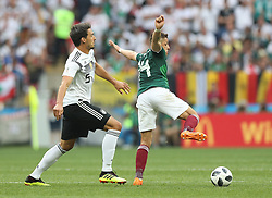 MOSCOW, June 17, 2018  Mats Hummels (L) of Germany vies with Javier Hernandez of Mexico during a group F match between Germany and Mexico at the 2018 FIFA World Cup in Moscow, Russia, June 17, 2018. (Credit Image: © Xu Zijian/Xinhua via ZUMA Wire)