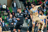 Newcastle Jets midfielder Kosta Petratos (19) wins the header at the FFA Cup Round 16 soccer match between Melbourne City FC v Newcastle Jets at AAMI Park in Melbourne.