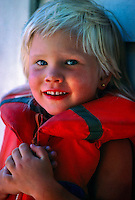Norwegian girl wearing lifejacket, Kragero (on the Oslo fjord), Norway