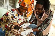 Midwife Dagnoko Alima Dambele shows  Mariam Keita, 20, how to breast feed her newborn child properly at the Badegna community health center in the town of Kita, Mali on Sunday August 29, 2010.