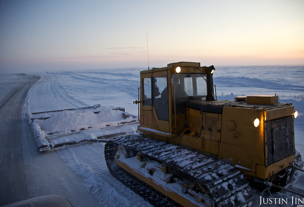 Every winter, workers build ice roads in the tundra to serve gas and oil companies exploring in the Nenets Autonomous Region in the Russian Arctic; and every summer, the roads melt away into the marshland.