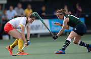 Den Bosch's Marloe Keetels challenges with Surbiton's Rebecca Middleton during their semi final of the EHCC 2017 at Den Bosch HC, The Netherlands, 3rd June 2017
