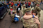 Coleen Smith, of Letcher, hugs her boyfriend Sgt. First Class Michael Hoffman after arriving at the Huron Arena for the 153rd Engineer Battalion's Deactivation Ceremony on Saturday morning in Huron. (Matt Gade / Republic)