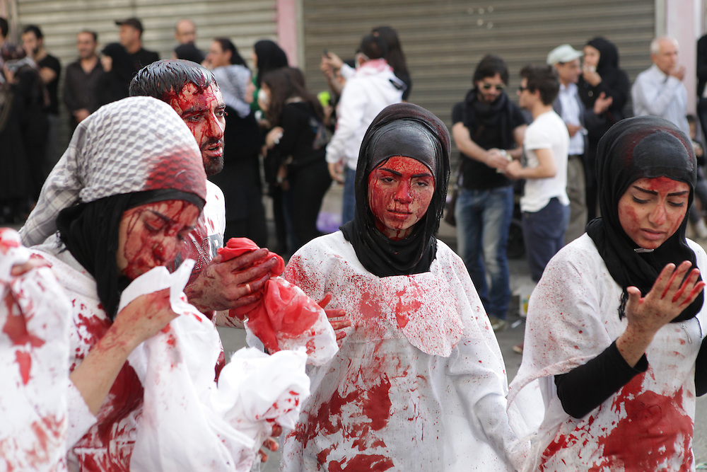 Blood ritual during the Day of Ashura, November 14. 2013 (Nabatieh, Lebanon). Wounds are self-inflicted by using traditional swords and knives. Some participants faint due to blood loss and are treated by paramedics in tents. Men, women, as well as children participate. The city of Nabatieh (a.k.a. Nabatiye, Nabatiyeh) is one of the few places where this particular ritual is still performed. It is even frowned upon by Hezbollah, who encourage people to donate blood at a local hospital instead.