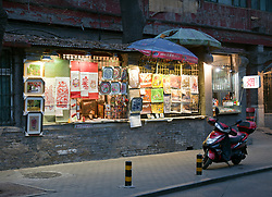 Street Scene: Sidewalk art stand, Shichahai (Houhai) District at Twilight, Beijing, China.