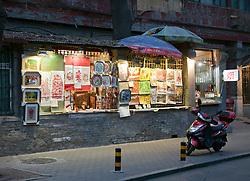 Street Scene: Sidewalk art stand, Shichahai (Houhai) District at Twilight, Beijing, China.