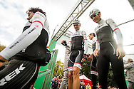 Trek Factory Racing team members leave the signature check podium of Il Lombardia 2015 Bergamo - Como