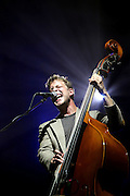 Ted Dwane of Mumford and Sons performs live on the NME Radio 1 stage during day one of Reading Festival on August 27, 2010 in Reading, England.  (Photo by Simone Joyner)