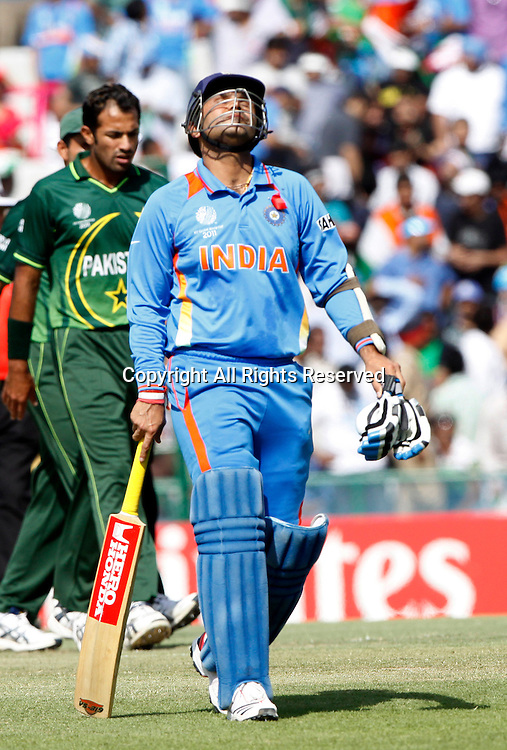 30.03.2011 Cricket World Cup from the Punjab Cricket Association Stadium, Mohali in Chandigarh. India v Pakistan.Virender Sehwag of India walks back after getting out during the match of the ICC Cricket World Cup between India and Pakistan.