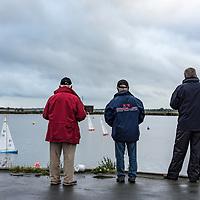 Old men sailing model boats on a boating lake