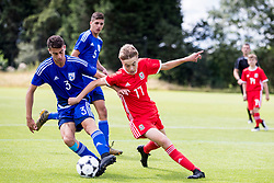 WREXHAM, WALES - Tuesday, August 13, 2019: Cyprus' Charalampos Antoniou and Wales Paige Wilding during the UEFA Under-15's Development Tournament match between Wales and Cyprus at Colliers Park. (Pic by Paul Greenwood/Propaganda)