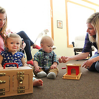 Adam Robison | BUY AT PHOTOS.DJOURNAL.COM<br /> Misty Coleman works in the infants room with Carol Alvis, infant teacher.