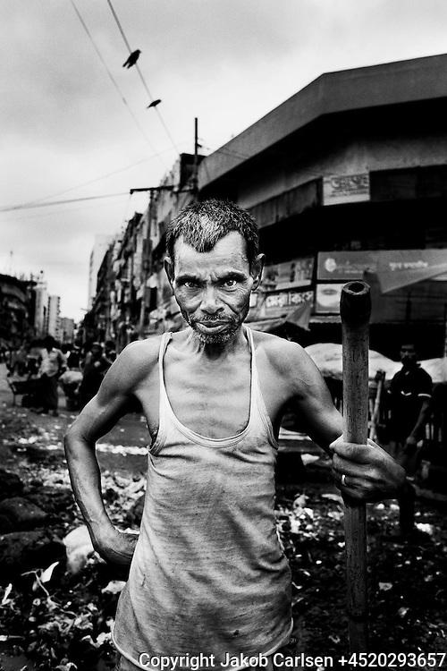 Manual scavenger working in the streets of Dhaka, Bangladesh.