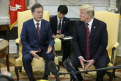 South Korean President Moon Jae-in speaks as President Donald Trump listens during a meeting in the Oval Office of the White House on May 22, 2018 in Washington DC.<br /> (Photo by Oliver Contreras/SIPA USA)