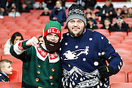 Newcastle United fans in and elf costume and a Christmas Jumper before the Barclays Premier League match at the Emirates Stadium, London<br /> Picture by David Horn/Focus Images Ltd +44 7545 970036<br /> 13/12/2014