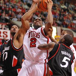 Feb 9, 2008; Piscataway, NJ, USA; Rutgers guard Anthony Farmer (2) battles Cincinnati guard Deonta Vaughn (5) and forward Marcus Sikes (10) during Rutgers' 72-68 loss at the Louis Brown Rutgers Athletic Center.