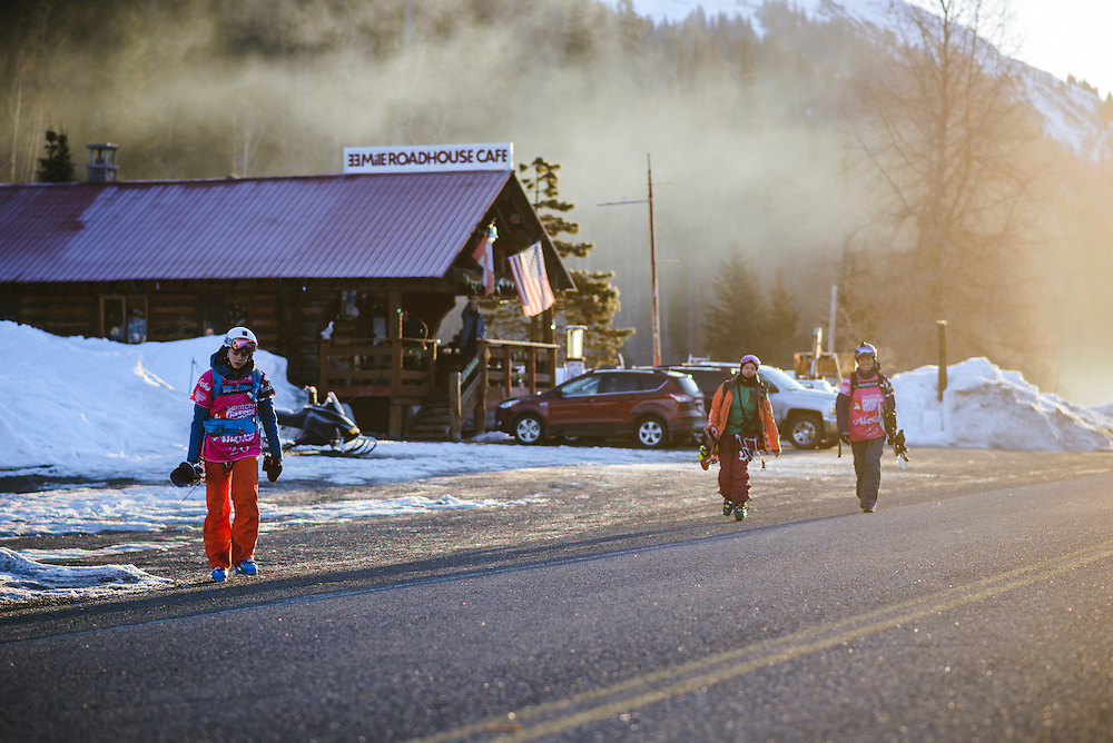 Lauren Cameron, Arianna Tricomi, and Anne-Flore Marxer walk towards the staging area for the Freeride World Tour in Haines, Alaska