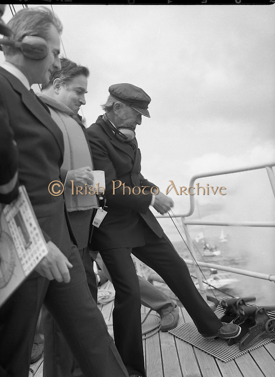 Round Europe Yacht Race.   (R61)..1987..25.07.1987..07.25.1987..25th July 1987..President Patrick Hillery started the Round Europe Yacht Race which began at Dun Laoghaire today...Image shows President Hillery firing the starting cannon watched by Mr Michael Noonan TD and Commissioner Peter Sutherland.