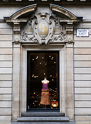 Fashion boutique window display within historic building in Merchant City area of Glasgow Scotland