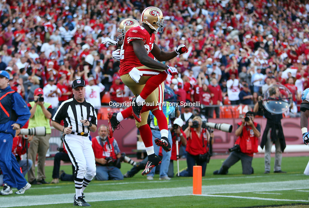 San Francisco 49ers wide receiver Jason Hill (89) hip bumps with Niners wide receiver Josh Morgan (84) after Hill catches a 12 yard pass good for a 17-10 lead during the NFL football game against the Tennessee Titans, November 8, 2009 in San Francisco, California. The Titans won the game 34-27. (©Paul Anthony Spinelli)