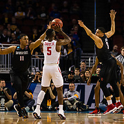 15 March 2018: San Diego State Aztecs forward Matt Mitchell (11) and guard Trey Kell (3) close down on Houston Cougars guard Corey Davis Jr. (5) as he attempts a long two point shot in the first half. The San Diego State Aztecs got knocked out in the first round by Houston on a last second layup to lose 67-65  at Intrust Bank Arena in Wichita, Kansas.