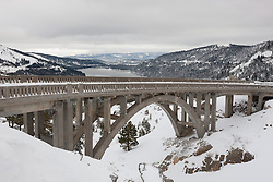"""Snowy Rainbow Bridge 1"" - Photograph of a snowy Rainbow Bridge in Truckee, California with Donner Lake in the background."