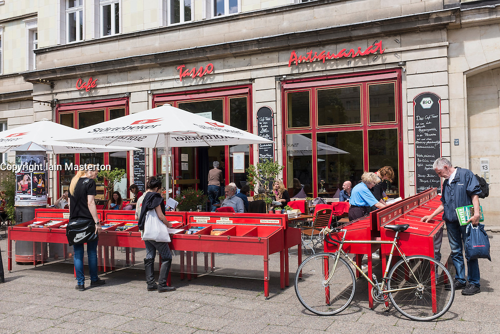 Cafe Tasso with outdoor bookstalls on Karl Marx Allee in former East Berlin Germany