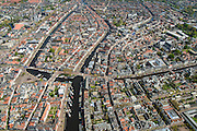 Nederland, Zuid-Holland, Leiden, 09-04-2014; binnenstad met midden links Beestenmarkt en Turfmarkt, water Rapenburg (naar rechts). Galgewater met schepen,  overgaand in Stille en Oude Rijn.<br /> Old town of the city of Leiden and branches of the river Rhine (Stille and Old).<br /> luchtfoto (toeslag op standard tarieven);<br /> aerial photo (additional fee required);<br /> copyright foto/photo Siebe Swart.