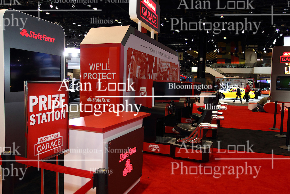 """12 February 2015: The State Farm Garage features a virtual driving course and a place to """"park and charge"""" your cellular phones and electronic devices to help you stay in touch while at the show.  #StateFarmGarage<br /> <br /> First staged in 1901, the Chicago Auto Show is the largest auto show in North America and has been held more times than any other auto exposition on the continent. The 2015 show marks the 107th edition of the Chicago Auto Show. It has been  presented by the Chicago Automobile Trade Association (CATA) since 1935.  It is held at McCormick Place, Chicago Illinois"""