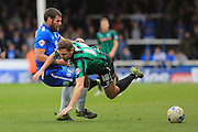 Michael Bostwick fouls Grant Holt during the Sky Bet League 1 match between Peterborough United and Rochdale at London Road, Peterborough, England on 9 April 2016. Photo by Daniel Youngs.