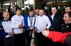 Slovenian bronze medalist cross-country skier Petra Majdic with her team members Miha Plahutnik, Marko Gracer, Stefan Lichon, Ivan Hudac at arrival to Airport Joze Pucnik from Vancouver after Winter Olympic games 2010, on March 1, 2010 in Brnik, Slovenia. (Photo by Vid Ponikvar / Sportida)