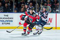 KELOWNA, CANADA - OCTOBER 27: Conner Bruggen-Cate #20 of the Kelowna Rockets is back checked by Carson Focht #17 of the Tri-City Americans during first period on October 27, 2017 at Prospera Place in Kelowna, British Columbia, Canada.  (Photo by Marissa Baecker/Shoot the Breeze)  *** Local Caption ***