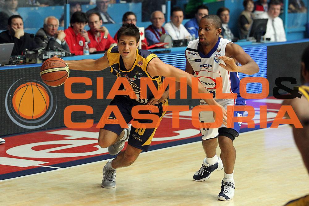DESCRIZIONE : Cantu Lega A 2010-11 Bennet Cantu Fabi Shoes Montegranaro<br /> GIOCATORE : Andrea Cinciarini<br /> SQUADRA : Fabi Shoes Montegranaro<br /> EVENTO : Campionato Lega A 2010-2011<br /> GARA : Bennet Cantu Fabi Shoes Montegranaro<br /> DATA : 02/04/2011<br /> CATEGORIA : Palleggio<br /> SPORT : Pallacanestro<br /> AUTORE : Agenzia Ciamillo-Castoria/G.Cottini<br /> Galleria : Lega Basket A 2010-2011<br /> Fotonotizia : Cantu Lega A 2010-11 Bennet Cantu Fabi Shoes Montegranaro<br /> Predefinita :