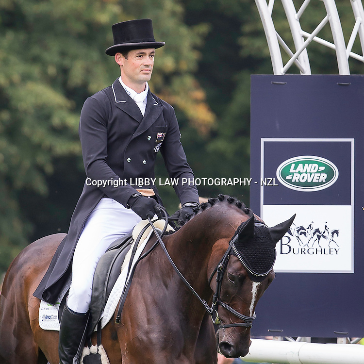 NZL-Jonathan Paget (CLIFTON PROMISE) INTERIM-1ST: SECOND DAY OF DRESSAGE: 2014 GBR-Land Rover Burghley Horse Trial (Friday 5 September) CREDIT: Libby Law COPYRIGHT: LIBBY LAW PHOTOGRAPHY - NZL