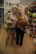 Cindy Jackson, Anneka Svenska and 'Suzy', Opening of The Mutz Nutz; Westbourne Park Rd. London. 23 August 2006.  ONE TIME USE ONLY - DO NOT ARCHIVE  © Copyright Photograph by Dafydd Jones 66 Stockwell Park Rd. London SW9 0DA Tel 020 7733 0108 www.dafjones.com