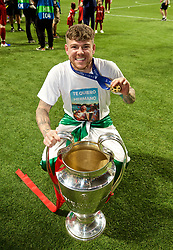 MADRID, SPAIN - SATURDAY, JUNE 1, 2019: Liverpool's Alberto Moreno with the trophy after the UEFA Champions League Final match between Tottenham Hotspur FC and Liverpool FC at the Estadio Metropolitano. Liverpool won 2-0 to win their sixth European Cup. (Pic by David Rawcliffe/Propaganda)