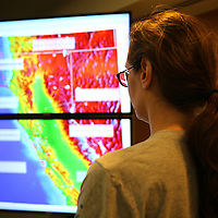 Research seismologist Ingrid Johnason, from the Berkeley Seismological Lab, views activity in Napa on a big screen monitor, as seen from a recording station located in Berkeley, California, on Sunday, August 24, 2014. The 6.1 magnitude earthquake caused significant damage and left three critically injured in California's northern Bay Area early Sunday, igniting fires, sending at least 87 people to a hospital, knocking out power to tens of thousands and sending residents running out of their homes in the darkness. Aftershocks are still being captured across the area by the data stations that are recording seismic data.(AP Photo/Alex Menendez)
