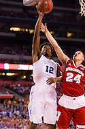 06 APR 2015:  Forward Justise Winslow (12) of Duke University shoots over Guard Bronson Koenig (24) of the University of Wisconsin during the championship game at the 2015 NCAA Men's DI Basketball Final Four in Indianapolis, IN. Duke defeated Wisconsin 68-63 to win the national title. Brett Wilhelm/NCAA Photos