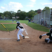 A young player wearing number 42 hits a pitch during the Norwalk Little League baseball competition at Broad River Fields,  Norwalk, Connecticut. USA. Photo Tim Clayton
